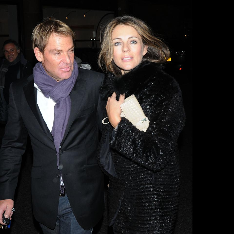 LONDON, UNITED KINGDOM - NOVEMBER 22: Liz Hurley and Shane Warne sighted in C London Restaurant on November 22, 2011 in London, England. (Photo by Sylvia Linares/FilmMagic)
