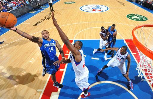 PHILADELPHIA, PA - APRIL 7: Jameer Nelson #14 of the Orlando Magic shoots against Elton Brand #42 of the Philadelphia 76ers on April 7, 2012 at the Wells Fargo Center in Philadelphia, Pennsylvania. (Photo by Jesse D. Garrabrant/NBAE via Getty Images)