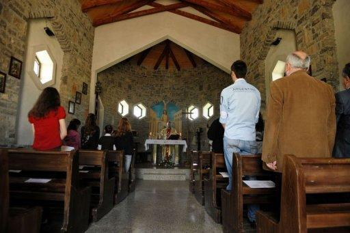 Villagers pray at a Catholic church in the village of Kravaseri in May 2012. Only about 50,000 of Kosovo's 1.7 million citizens are Catholics, while more than 90 percent of the population are Muslim