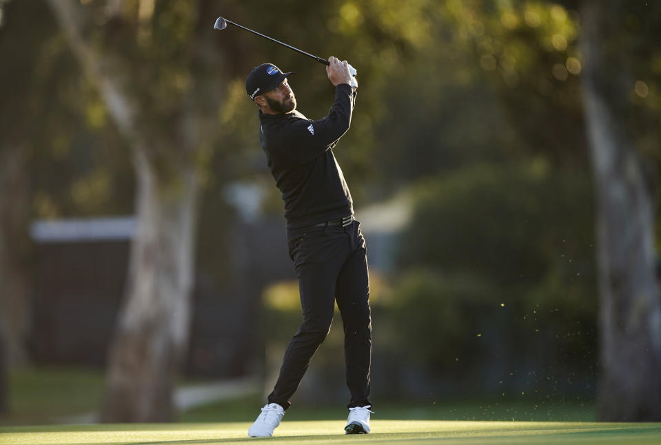 Dustin Johnson hits his second shot on the third hole during the Genesis Invitational pro-am golf event at Riviera Country Club, Wednesday, Feb. 17, 2021, in the Pacific Palisades area of Los Angeles. (AP Photo/Ryan Kang)