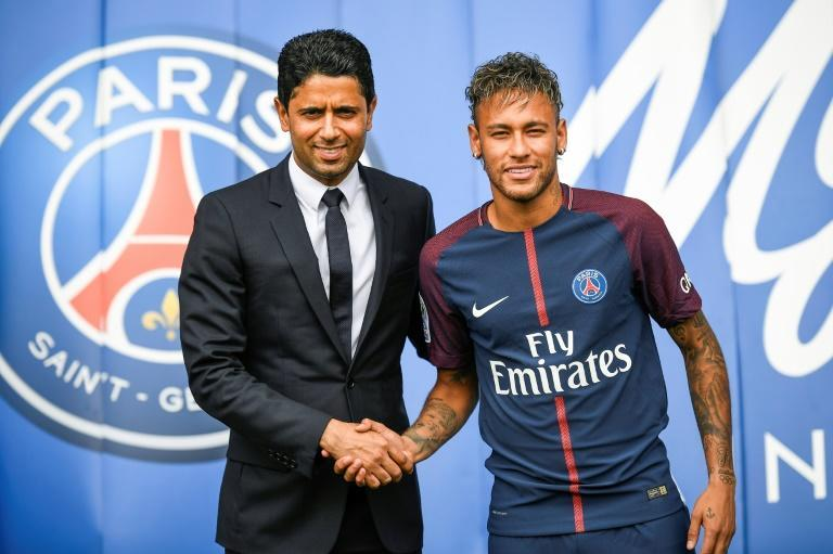 Neymar (right) shakes hands with Paris Saint Germain's Qatari president Nasser Al-Khelaifi (left)after his world record 222 million euro move from Barcelona in 2017