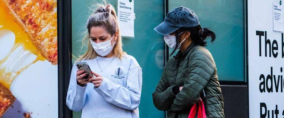 NEW YORK, NEW YORK - APRIL 01, 2020: A long line outside of Whole Foods in Tribeca, New York as the store has implemented social distancing measures during the COVID-19 pandemic.