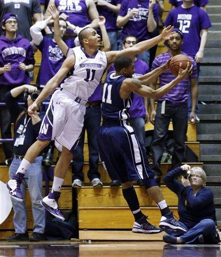 Northwestern guard Reggie Hearn, left, battles Penn State guard Jermaine Marshall for a rebound during the first half of an NCAA college basketball game, Thursday, March 7, 2013, in Evanston, Ill. (AP Photo/Charles Rex Arbogast)