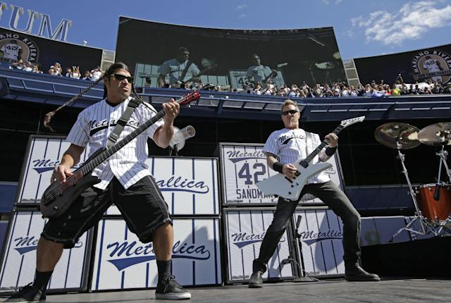 "Metallica's Robert Trujillo, left, and James Hetfield perform during a pregame ceremony for New York Yankees relief pitcher Mariano Rivera at Yankees Stadium before the Yankees baseball game against the San Francisco Giants, Sunday, Sept. 22, 2013, in New York. Rivera's signature song when he comes into the game is ""Enter Sandman"" by the band. (AP Photo/Kathy Willens, Pool)"