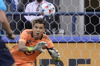 Minnesota United goalkeeper Dayne St. Clair dives to make a stop on a shot by Seattle Sounders defender Xavier Arreaga (not shown) during the first half of an MLS soccer match, Friday, April 16, 2021, in Seattle. (AP Photo/Ted S. Warren)