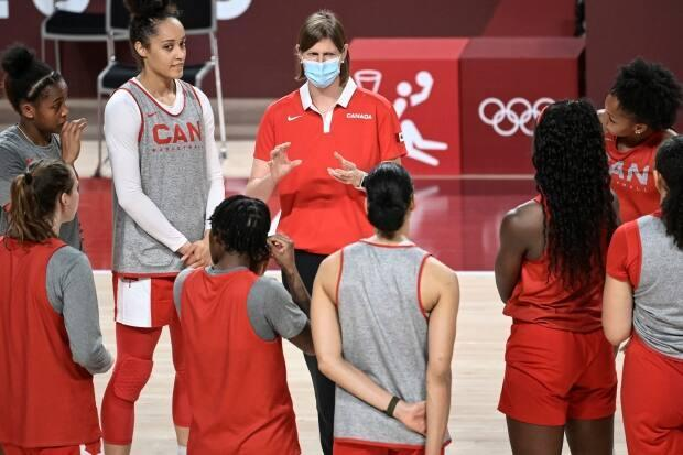 Canada's Olympic basketball team head coach Lisa Thomaidis, centre-back, oversaw the program's rise to fourth in the world before her departure after Tokyo 2020. (Aris Messinis/AFP via Getty Images - image credit)
