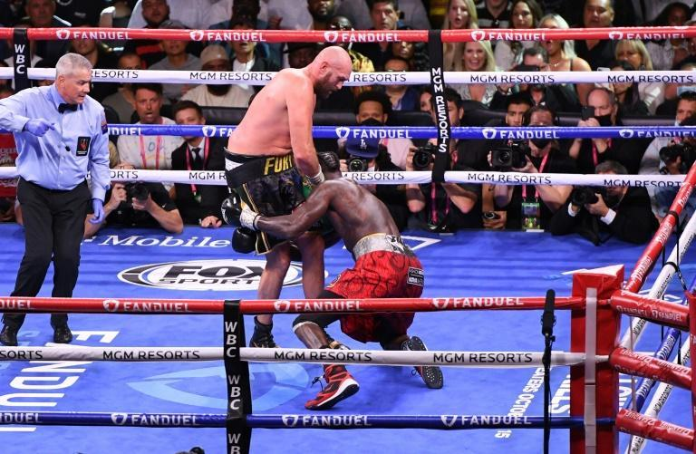 WBC heavyweight champion Tyson Fury of Great Britain knocks out US challenger Deontay Wilder in the 11th round of the fight for the WBC heavyweight world title in Las Vegas (AFP/Robyn Beck)