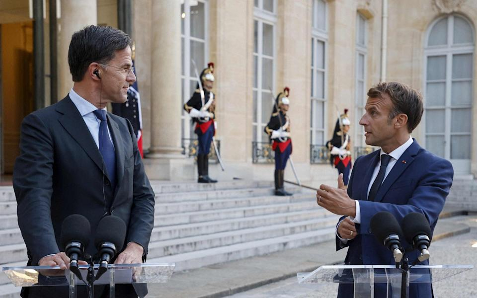 Mark Rutte, the Dutch prime minister, towers over Emmanuel Macron, the 5ft 9in tall French President during a visit to Paris in August. - AFP