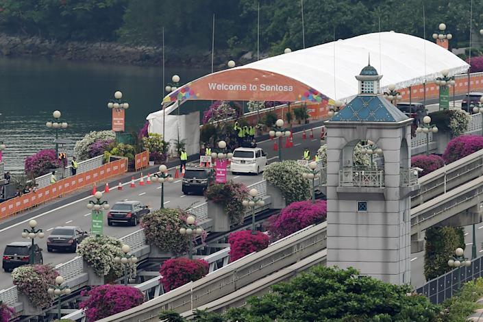 Kim's motorcade heads to Sentosa, the resort island where the summit is taking place.