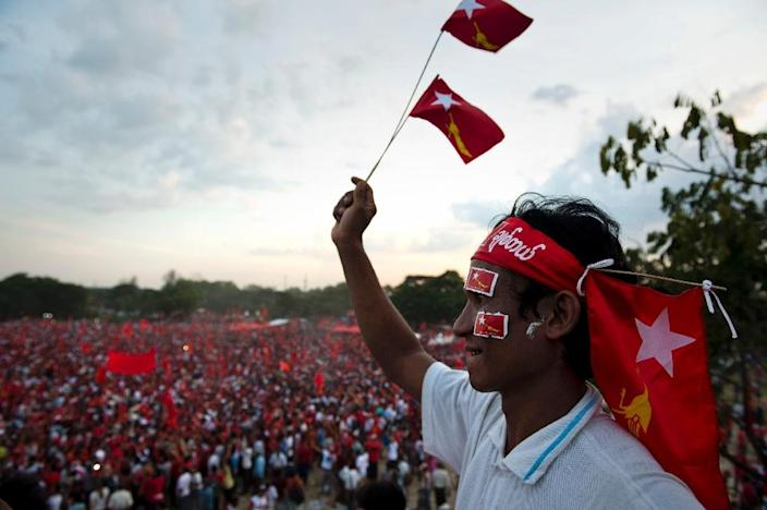 A supporter looks on as thousands of others attend a National League for Democracy (NLD) rally attended by Myanmar opposition leader Aung San Suu Kyi in Yangon on November 1, 2015 ahead of polls (AFP Photo/Romeo Gacad)