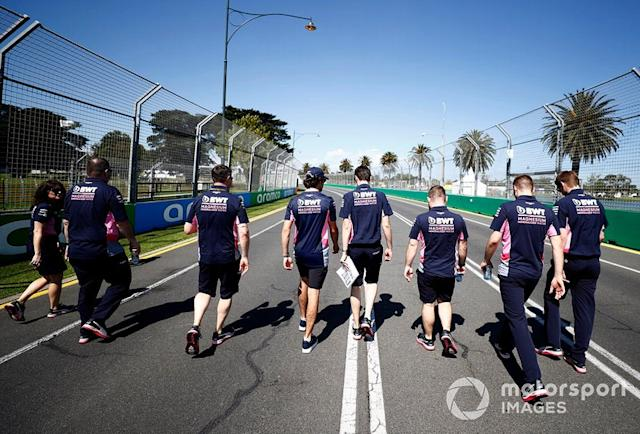 """Lance Stroll, Racing Point on his track walk with members of the team. <span class=""""copyright"""">Glenn Dunbar / Motorsport Images</span>"""