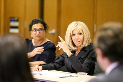 Mrs. Brigitte Macron, First Lady of France, listens as Windward alumnus and current trustee Denis J. O'Leary, III describes his experiences before attending The Windward School and his success after attending The Windward School.