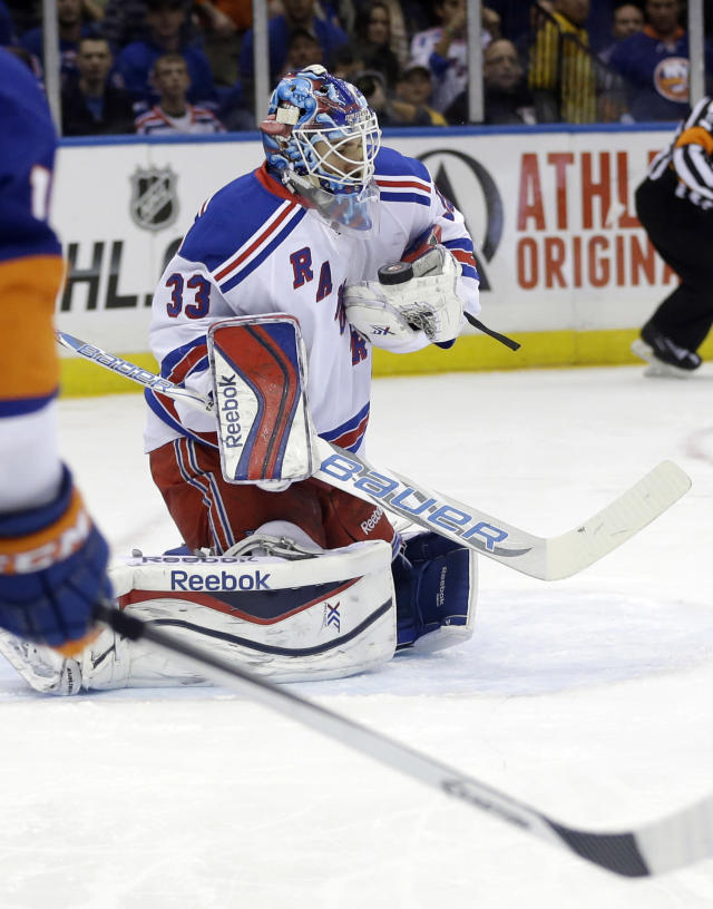 New York Rangers goalie Cam Talbot (33) stops a shot on the goal during the second period of an NHL hockey game against the New York Islanders Tuesday, Oct. 29, 2013, in Uniondale, N.Y. (AP Photo/Frank Franklin II)
