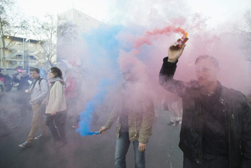 Anti-gay marriage activists hold smoke flares with the color of the logo of the movement during a rally to protest the new law after French lawmakers legalized same-sex marriage, Tuesday, April 23, 2013, in Paris. Lawmakers legalized same-sex marriage after months of debate and street protests that brought many thousands to protest in Paris. Tuesday's 331-225 vote came in the Socialist majority National Assembly and France's justice minister, Christiane Taubira, said the first weddings could be as soon as June. (AP Photo/Michel Euler)