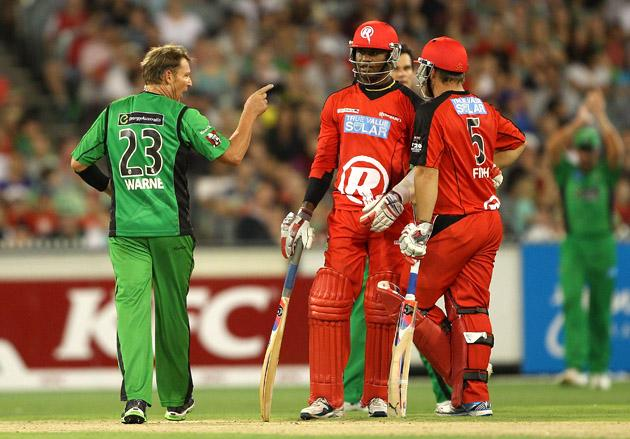 MELBOURNE, AUSTRALIA - JANUARY 06:  Shane Warne of the Stars points his finger towards Marlon Samuels of the Stars during the Big Bash League match between the Melbourne Stars and the Melbourne Renegades at Melbourne Cricket Ground on January 6, 2013 in Melbourne, Australia.  (Photo by Robert Prezioso/Getty Images)