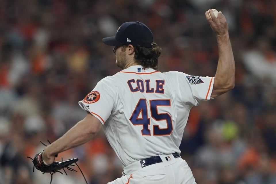 Houston Astros starting pitcher Gerrit Cole throws during the first inning of Game 1 of the baseball World Series against the Washington Nationals Tuesday, Oct. 22, 2019, in Houston. (AP Photo/David J. Phillip)