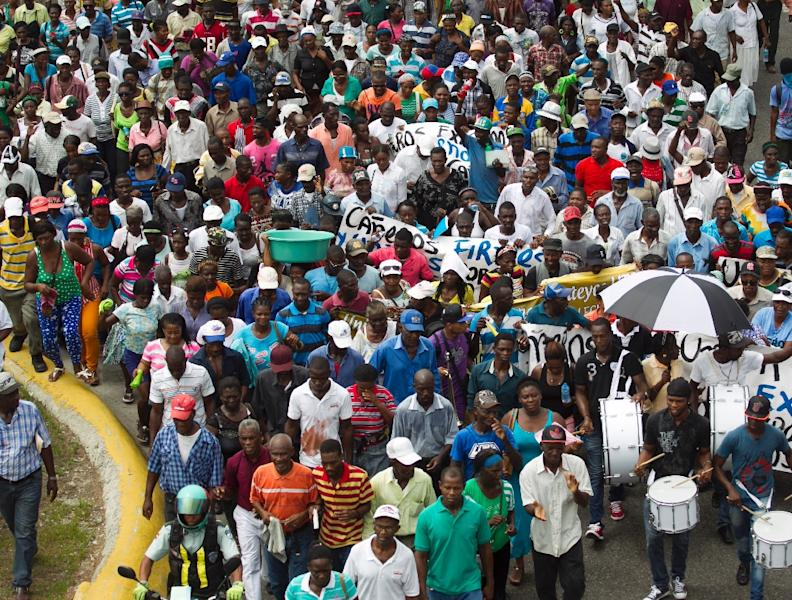 Haitian sugar cane workers march towards the constitutional court where they have lodged an appeal to prevent being deported after working all their life in the sugar cane fields of the Dominican Republic, on June 25, 2015 in Santo Domingo (AFP Photo/Erika Santelices)
