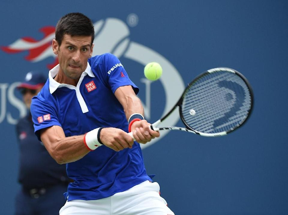 Novak Djokovic returns a shot to Joao Souza during their US Open match at the USTA Billie Jean King National Tennis Center on August 31, 2015 (AFP Photo/Timothy A. Clary)