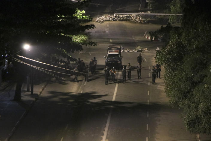 Armed police patrol a street in downtown Yangon, Myanmar, Sunday, March 21, 2021. Protests against the coup continued in cities and town across the country, including in Mandalay and Yangon. (AP Photo)