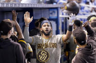 San Diego Padres' Fernando Tatis Jr. celebrates after hitting a solo home run during the first inning of a baseball game against the Miami Marlins, Saturday, July 24, 2021, in Miami. (AP Photo/Lynne Sladky)