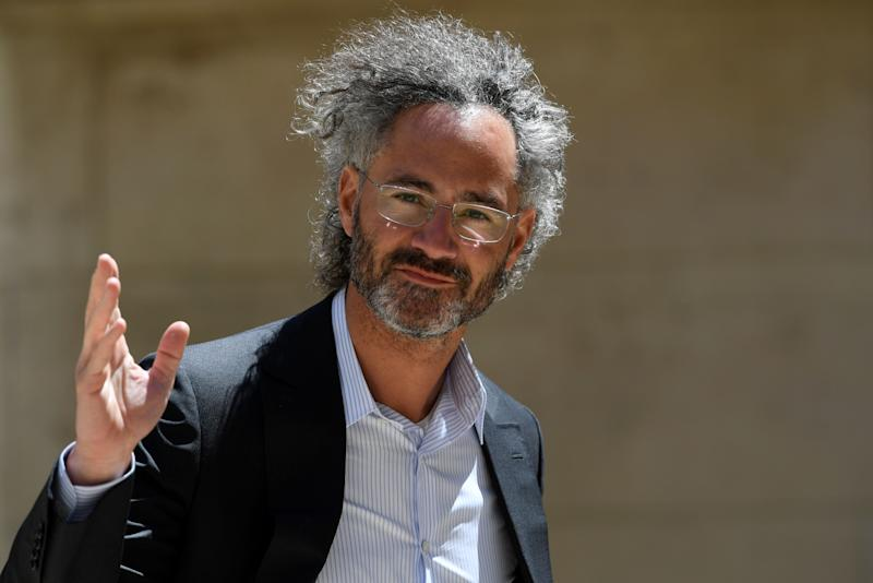 """Alex Karp, CEO of Palantir arrives ahead of a """"Tech For Good"""" meetup at Hotel Marigny in Paris on May 15, 2019, held to discuss good conduct for technology giants. - French President and New Zealand's premier will host other world leaders and leading tech chiefs to launch an ambitious new initiative known as the """"Christchurch call"""" aimed at curbing extremism online. The political meeting will run in parallel to an initiative launched by the French President called """"Tech for Good"""" which will bring together 80 tech chiefs in Paris to find a way for new technologies to work for the common good. (Photo by Bertrand GUAY / AFP) (Photo credit should read BERTRAND GUAY/AFP via Getty Images)"""