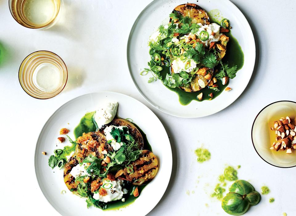 """Here, we sneak the kale in—it's blended into a vibrantly green sauce. <a href=""""https://www.bonappetit.com/recipe/grilled-green-tomatoes-with-burrata-and-green-juice?mbid=synd_yahoo_rss"""" rel=""""nofollow noopener"""" target=""""_blank"""" data-ylk=""""slk:See recipe."""" class=""""link rapid-noclick-resp"""">See recipe.</a>"""