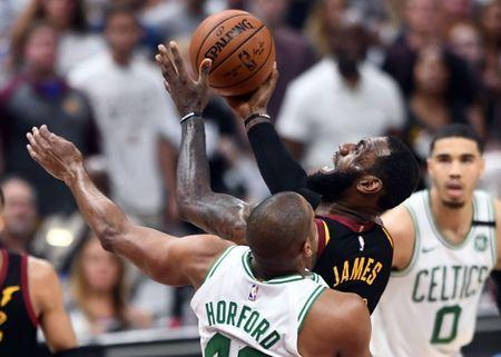 May 25, 2018; Cleveland, OH, USA; Cleveland Cavaliers forward LeBron James (23) drives to the basket against Boston Celtics forward Al Horford (42) during the fourth quarter in game six of the Eastern conference finals of the 2018 NBA Playoffs at Quicken Loans Arena. Mandatory Credit: Ken Blaze-USA TODAY Sports