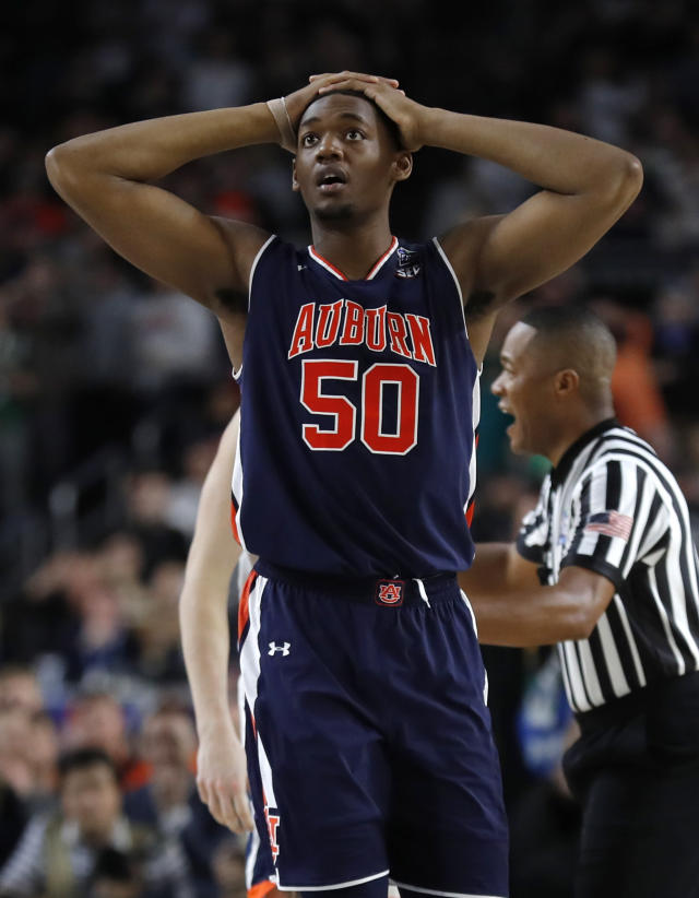 Auburn center Austin Wiley reacts at the end of a semifinal round game against Virginia in the Final Four NCAA college basketball tournament, Saturday, April 6, 2019, in Minneapolis. (AP Photo/Charlie Neibergall)