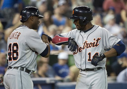 Detroit Tigers centre fielder Austin Jackson, right, celebrates his two-run home run with teammate Torii Hunter, left, while playing against the Toronto Blue Jays during eighth-inning AL baseball game action in Toronto, Thursday, July 4, 2013. (AP Photo/The Canadian Presss/Nathan Denette)