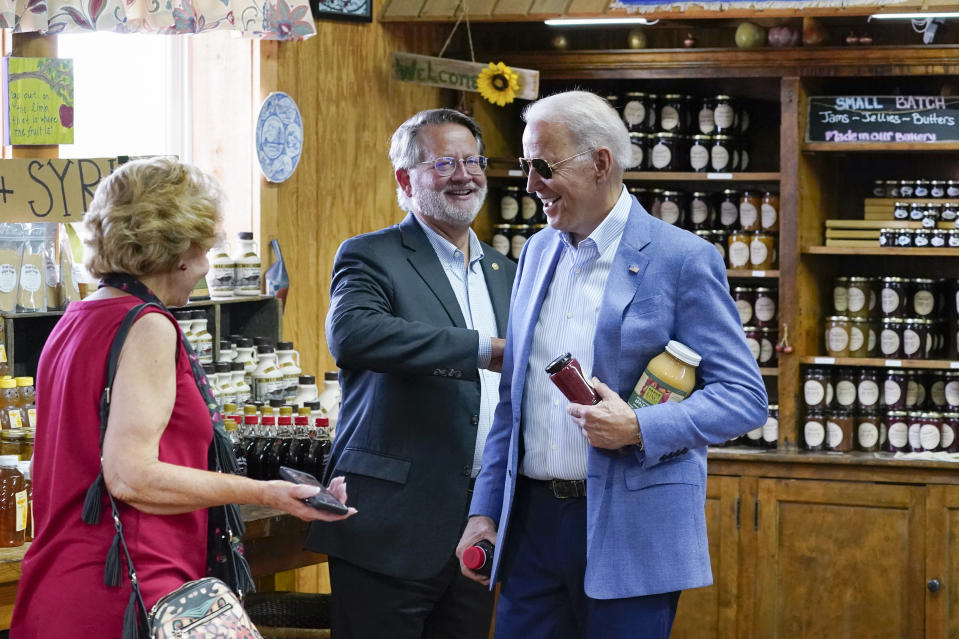 President Joe Biden visits the store at King Orchards fruit farm with Sen. Debbie Stabenow, D-Mich., and Sen. Gary Peters, D-Mich., Saturday, July 3, 2021, in Central Lake, Mich. (AP Photo/Alex Brandon)