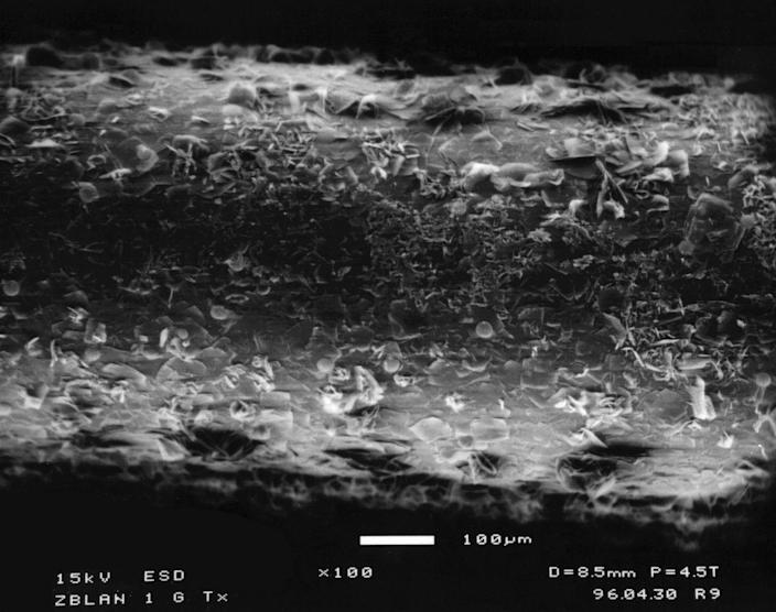 ZBLAN fibers processed on the ground have a tree-bark-like structure on the outside, whereas ZBLAN made in space doesn't show crystallization. <cite>NASA</cite>