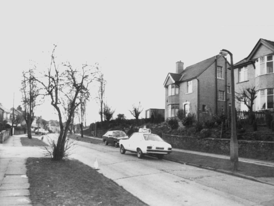 Sutcliffe's house in Bradford. A police panda car outside the house in Garden Lane, Bradford (centre), the home of Peter and Sonia Sutcliffe. Police have named Peter Sutcliffe as the man who is helping them with their enquiries into the Yorkshire Ripper killings. (AP-Photo)  1981