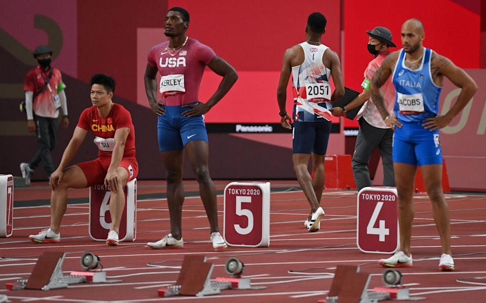 Zharnel Hughes has to leave the track after being disqualified for a false start - AFP