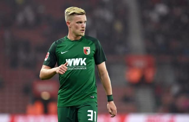 Philipp Max grabbed a dramatic late equaliser for Augsburg (Simon Galloway/AP)