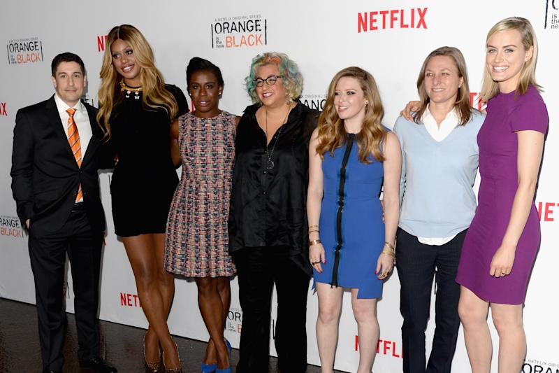 "(L-R) Jason Biggs, Laverne Cox, Uzo Aduba, Jenji Kohan, Natasha Lyonne, Netflix VP of Original Content Cindy Holland and actress Taylor Schilling at an ""Orange is the New Black"" panel discussion in LA on August 4, 2014 (AFP Photo/Jason Merritt)"