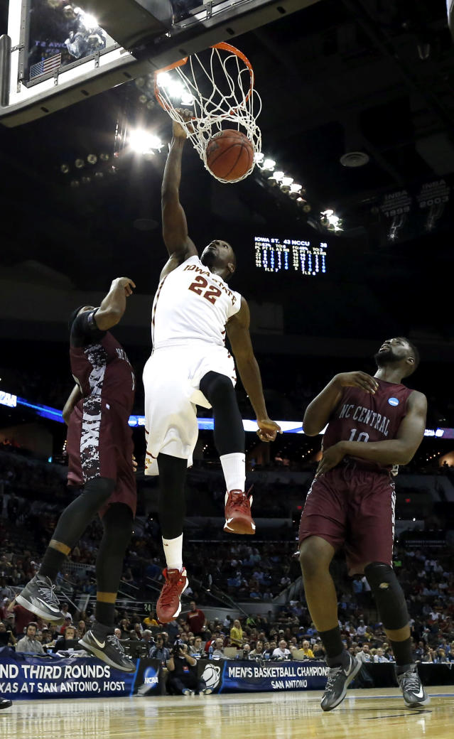 Iowa State Cyclones's Dustin Hogue (22) dunks the ball as North Carolina Central's Karamo Jawara (10) and Ebuka Anyaorah, left, defend during the first half of a second-round game in the NCAA college basketball tournament Friday, March 21, 2014, in San Antonio. (AP Photo/David J. Phillip)