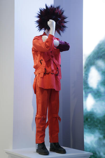 """A design by John Galliano for the House of Dior is shown at the Metropolitan Museum of Art's exhibit, """"Punk: Chaos to Couture,"""" Monday, May 6, 2013 in New York. The show, which examines punk's impact on high fashion from the movement's birth in the 1970s through its continuing influence today, is open May 9 through August 14. (AP Photo/Mark Lennihan)"""