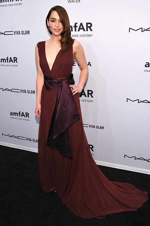 Emilia Clarke attends the amfAR New York Gala to kick off Fall 2013 Fashion Week at Cipriani Wall Street on February 6, 2013 in New York City.