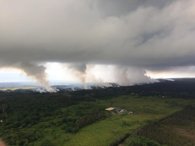 <p>This Wednesday, May 16, 2018, image provided by the U.S. Geological Survey shows sulfur dioxide plumes rising from fissures along the rift and accumulating in the cloud deck, viewed from the Hawaiian Volcano Observatory overflight in the morning at 8:25 a.m., HST near Pahoa, Hawaii. Plumes range from 1 to 2 kilometers (3,000 to 6,000 feet) above the ground. Officials say some vents formed by Kilauea volcano are releasing such high levels of sulfur dioxide that the gas poses an immediate danger to anyone nearby. (Photo: U.S. Geological Survey via AP) </p>