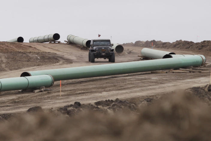<p>A vehicle drives next to a series of pipes at a Dakota Access Construction site near the town of Cannon Ball, N.D., on Oct. 30, 2016. (Josh Morgan/Reuters) </p>