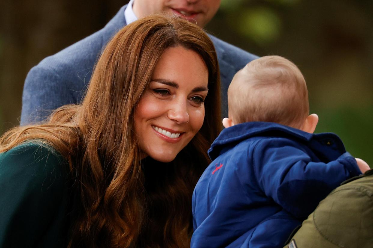 EDINBURGH, SCOTLAND - MAY 27: Catherine, Duchess of Cambridge smiles at baby Penelope Stewart during a visit to Starbank Park on May 26, 2021 in Edinburgh, Scotland. (Photo by Phil Noble - WPA Pool/Getty Images)
