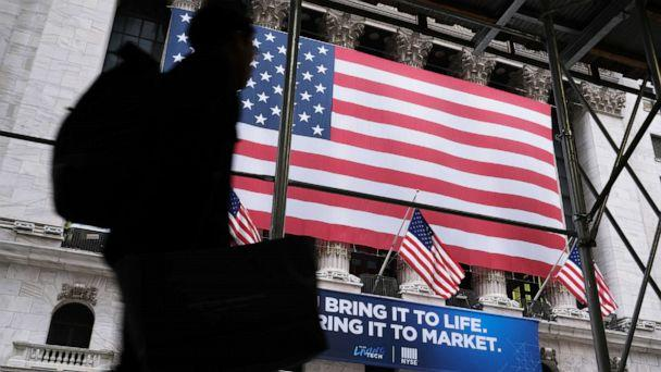 PHOTO: People walk past the New York Stock Exchange (NYSE), Feb. 12, 2020, in New York. (Spencer Platt/Getty Images)