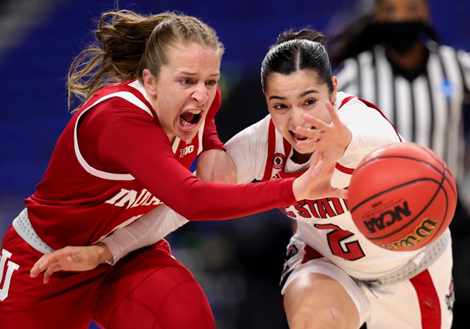 Nicole Cardano-Hillary #4 of the Indiana Hoosiers and Raina Perez #2 of the NC State Wolfpack chase a loose ball during the first half in the Sweet Sixteen round of the NCAA Women's Basketball Tournament at the Alamodome on March 27, 2021 in San Antonio, Texas. (Photo by Carmen Mandato/Getty Images)