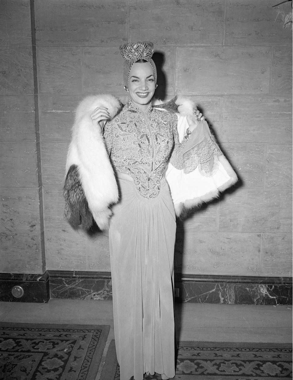 <p>The iconic Portugese-born Brazilian singer, dancer, and actress wore a stunning gown with a beaded bodice, fur coat, and patterned head wrap to the awards. This same year she starred in the musical flick, <em>That Night in Rio</em>. </p>