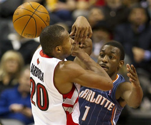 Toronto Raptors guard Leandro Barbosa (20) loses control of the ball under pressure from Charlotte Bobcats guard Kemba Walker (1) during the fourth quarter of an NBA basketball game, Friday, Feb. 17, 2012, in Toronto. The Bobcats won 98-91. (AP Photo/The Canadian Press, Frank Gunn)