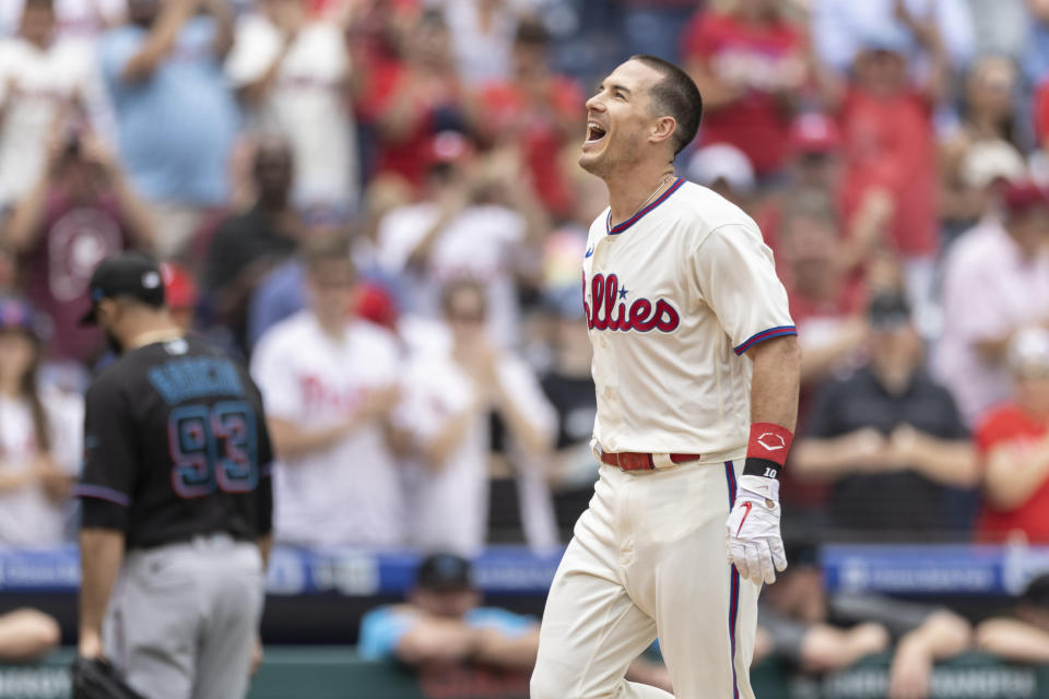 Philadelphia Phillies' J.T. Realmuto (10) cheers while running to home after hitting the winning home run in the 10th inning of a baseball game against the Miami Marlins, Sunday, July 18, 2021, in Philadelphia. It was a continuation of the previous day's game which was suspended due to rain. (AP Photo/Laurence Kesterson)