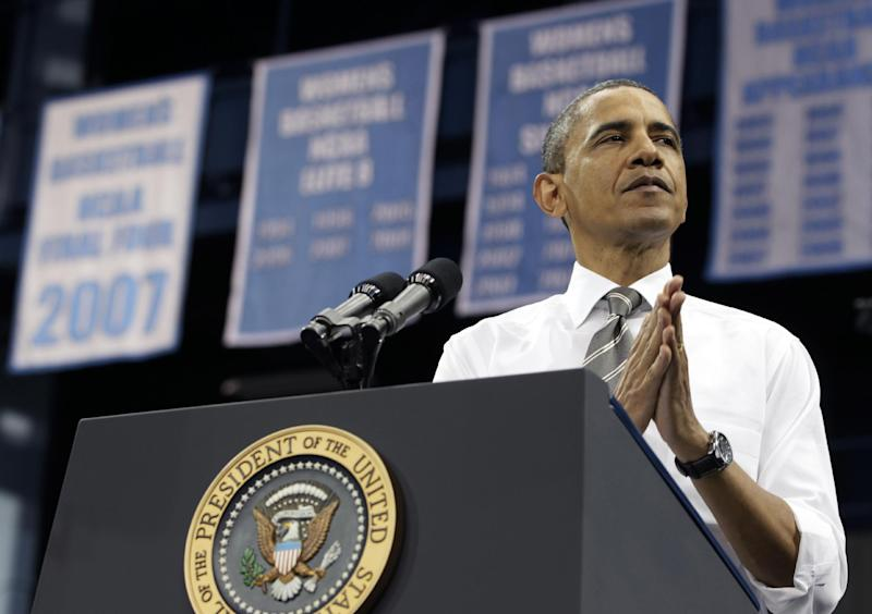 FILE - In this April 24, 2012 file photo, President Barack Obama pauses as he speaks at the University of North Carolina at Chapel Hill. The Senate has rejected Democratic and Republican plans for averting a doubling of interest rates on federal college loans for 7.4 million students.  (AP Photo/Carolyn Kaster, File)