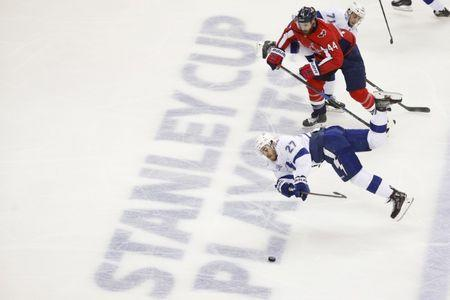 May 21, 2018; Washington, DC, USA; Tampa Bay Lightning defenseman Ryan McDonagh (27) falls to the ice after chasing the puck against Washington Capitals defenseman Brooks Orpik (44) during the second period in game six of the Eastern Conference Final in the 2018 Stanley Cup Playoffs at Capital One Arena. Mandatory Credit: Amber Searls-USA TODAY Sports