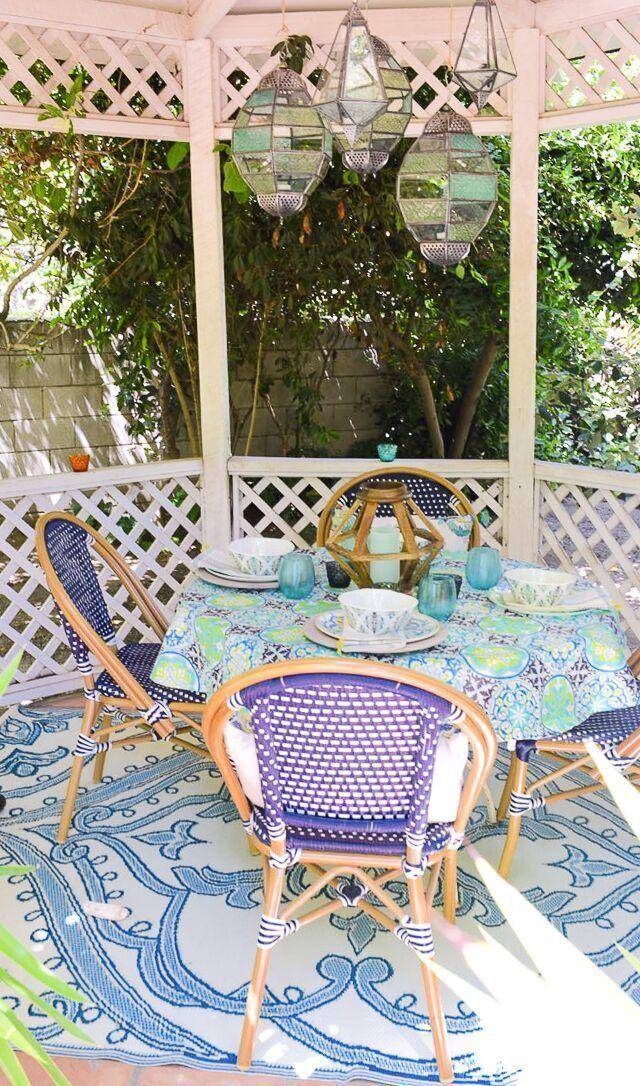 """<p>Stained glass lanterns and brightly colored patterns bring preppy style to this traditional white wood gazebo. This space is equally perfect for romantic dinners for two or entertaining friends. </p><p><strong>Get the look at <a href=""""https://www.attagirlsays.com/backyard-design-ideas/"""" rel=""""nofollow noopener"""" target=""""_blank"""" data-ylk=""""slk:Atta Girl Says"""" class=""""link rapid-noclick-resp"""">Atta Girl Says</a>. </strong></p><p><a class=""""link rapid-noclick-resp"""" href=""""https://go.redirectingat.com?id=74968X1596630&url=https%3A%2F%2Fwww.worldmarket.com%2Fproduct%2Flarge%2Bmulticolored%2Bglass%2Bhanging%2Bball%2Braya%2Blantern.do&sref=https%3A%2F%2Fwww.countryliving.com%2Fdiy-crafts%2Fg30932979%2Fgazebo-ideas%2F"""" rel=""""nofollow noopener"""" target=""""_blank"""" data-ylk=""""slk:SHOP STAINED GLASS LANTERNS"""">SHOP STAINED GLASS LANTERNS</a></p>"""