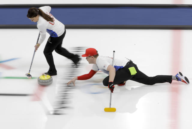 <p>United States' Matt Hamilton throws a stone, right, as his sister and teammate Becca sweeps the ice during a mixed doubles curling match against China's Wang Rui and Ba Dexin at the 2018 Winter Olympics in Gangneung, South Korea, Saturday, Feb. 10, 2018. (AP Photo/Natacha Pisarenko) </p>